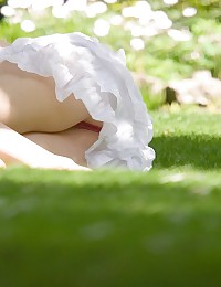 Upskirt white, pleated skirt hides tight butt