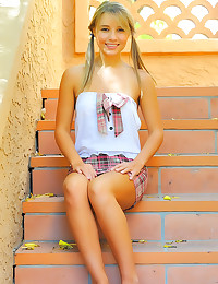 Cute teen pigtails posing outdoors