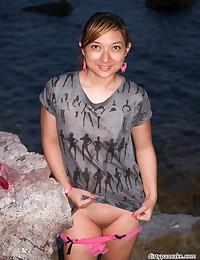 Cute Asian flashing outdoors