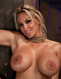 All American hot MILF with huge tits, is oiled up, severely bound, watered down, and made to cum over and over. Brutal breast bondage at its best.