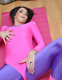 Wild Anna - Hot girl with pierced nipples slides out of her glossy spandex leotard