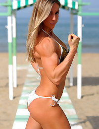 Stare at softcore photos of gorgeous well-tanned muscle girls that are waiting for you on these pics.