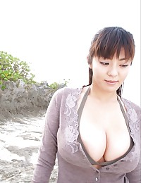 Nemoto Harumi posing her big breasts in hot dress