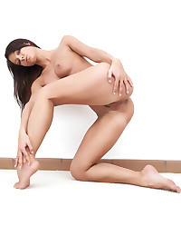 Melisa lies on the floor and gives us her sexiest poses.