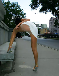 Upskirt outdoors with shiny p...
