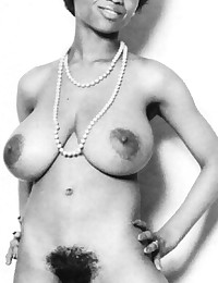 Black retro babe showing massive real tits