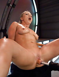 Champion Gymnast stretches her tight, hot body out for a machine fucking. The high powered custom drill fucks her pussy and ass in a perfect shag.