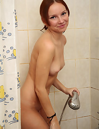 Tiny Miley - Teen redhead takes a shower and plays with herself in front of mirror