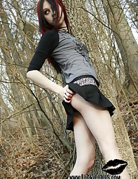 Liz Vicious - In the woods on a cool fall day showing us her little tits