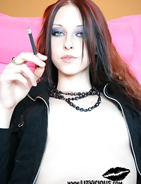 Liz Vicious - She smokes and looks directly into the camera with lust