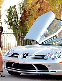 Posing with the expensive car...