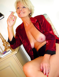 Mature blonde smokes lustily