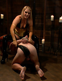 Ashley Edmonds suspends slaveboy from the ceiling and makes him lick her ass to orgasm, brutally canes him then fucks him for only her pleasure.