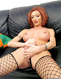 Shemale plays with her fat cock