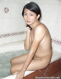 Skinny Asian takes a bath