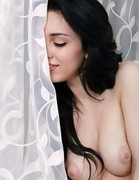 This brunette has enormous tits!
