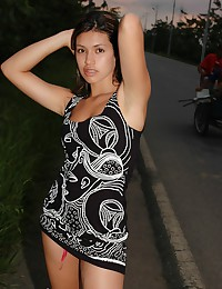 Pamela Spice - A tight black dress on the girl modeling by the road