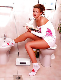 Slim tanned girl bathroom str...