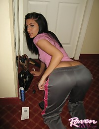 Her shiny workout pants are tight against her ass and Raven Riley wears a pink tee with them.