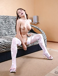 She parts her white stockings legs and gives us an eyeful of her pink slit