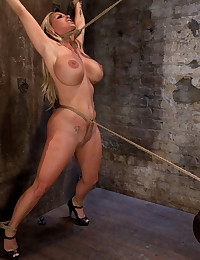 Smoking hot blond MILF with HUGE tits is bound spread, made to cum over and over. Suffers brutal crotch rope, as she is pulled to the breaking point.