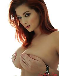 Gorgeous redhead Lucy Vixen gives a great view of her natural tits