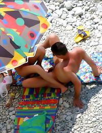 She sits on dick on beach