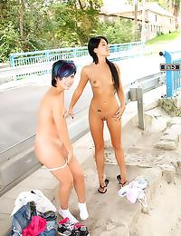 Lesbians fool around in publi...