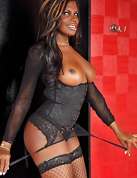 Big cock black tgirl shows off in lingerie