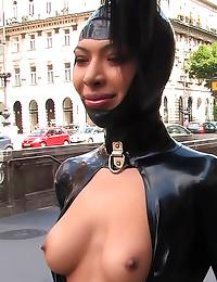 Rubber bondage girl public di...