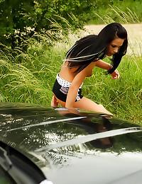 Skinny slut fucked on his car
