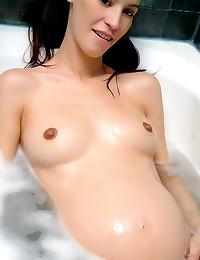 Seductive preggo bathes her s...