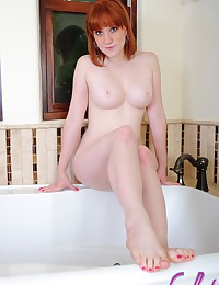 Naked redhead with big boobs ...