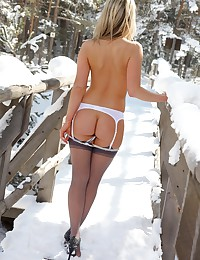 Skimpy lingerie makes this snow day hot as hell with the blonde model