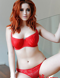 Arousing red lingerie on a redheaded hottie with perfect body