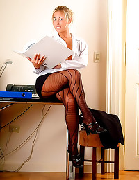 Office blonde in black pantyh...