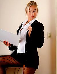 Office blonde in black pantyh...