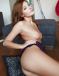 Redhead and her beautiful natural breasts put on a show in erotic art