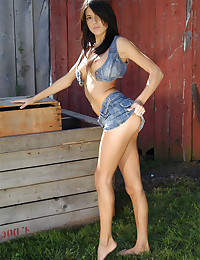 Tiny denim skirt on a brunette cutie with a nice set of perky tits