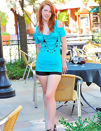Slender teen redhead in dress