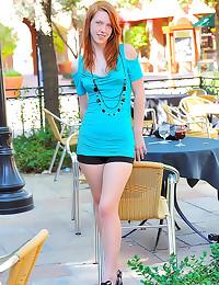 Slender teen redhead in dress