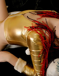 Her shiny gold top and pants are skintight and hug her tits and bottom well