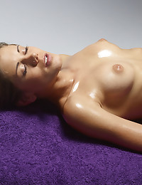 Caprice is in repose, completely naked from the start.