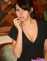 Kissable Kaydin - Babe in a low cut black top doing a sensual striptease