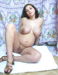 Preggo babe shows off her pussy