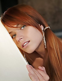 Slender redhead with gorgeous little natural tits makes nude art