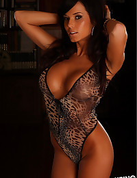 Animal print lingerie clings tight to her sexy body