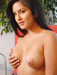 Sexy satin bra clings to the natural tits of pornstar Sunny Leone