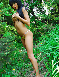Black haired teenage girl Francesca models her sexy topless body outdoors