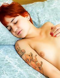 Sexy solo tattooed redhead